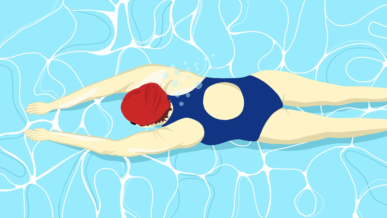 Woman in a bathing suit and swimming cap, exercising in a pool