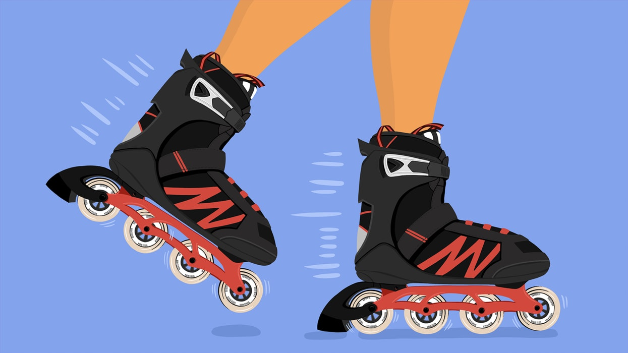 Black and red rollerblades in motion