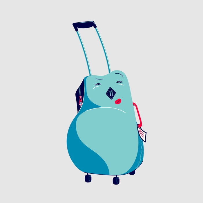 Small suitcase on wheels with a smiling face