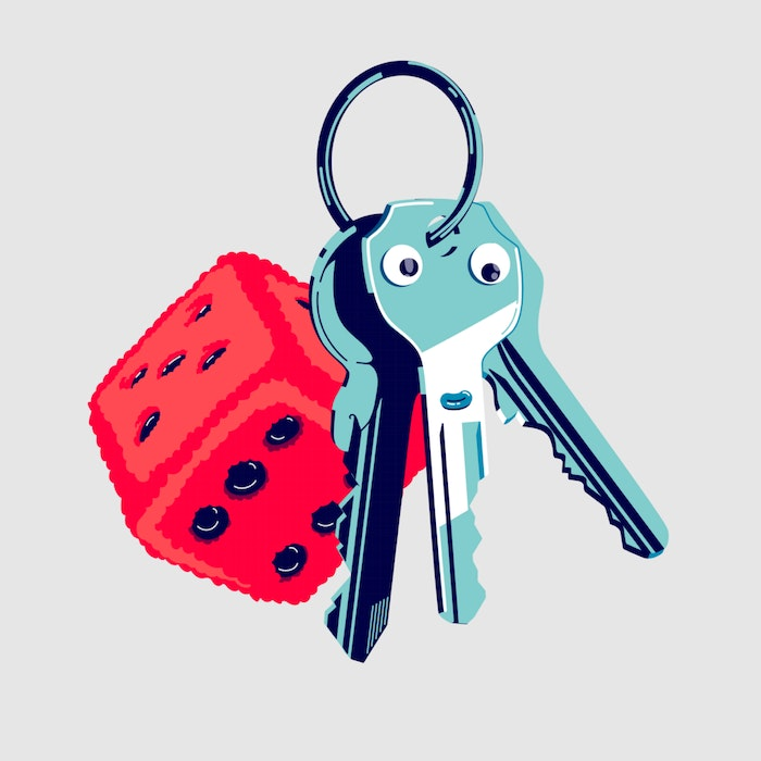 Ring of keys with a red fluffy dice