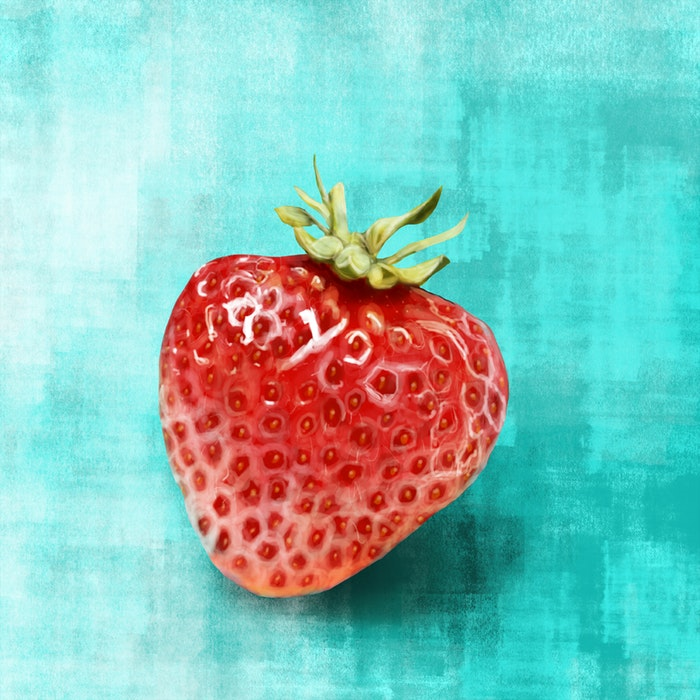 Fresh strawberry on a solid background