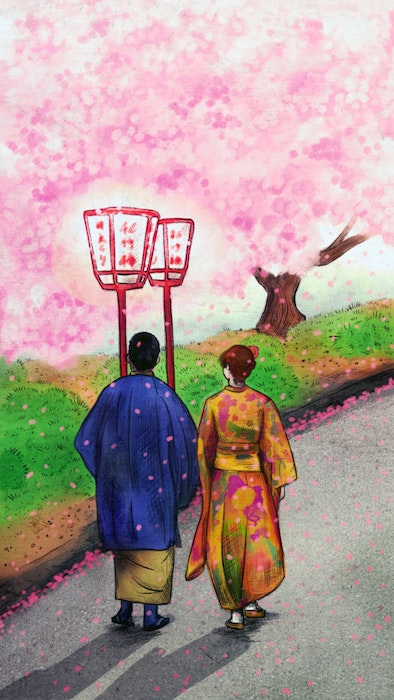 Couple in traditional Japanese clothing walking past blooming cherry blossom trees