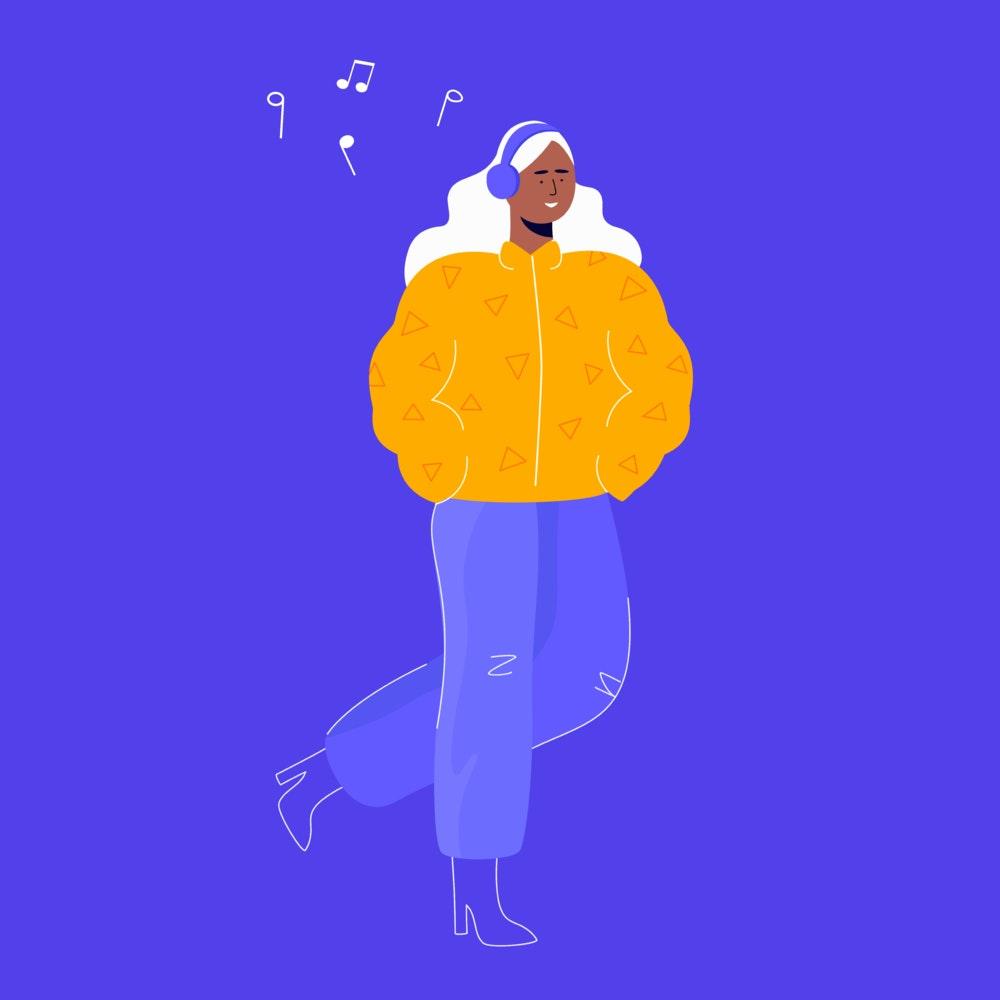 Woman walking, listening to music through headphones