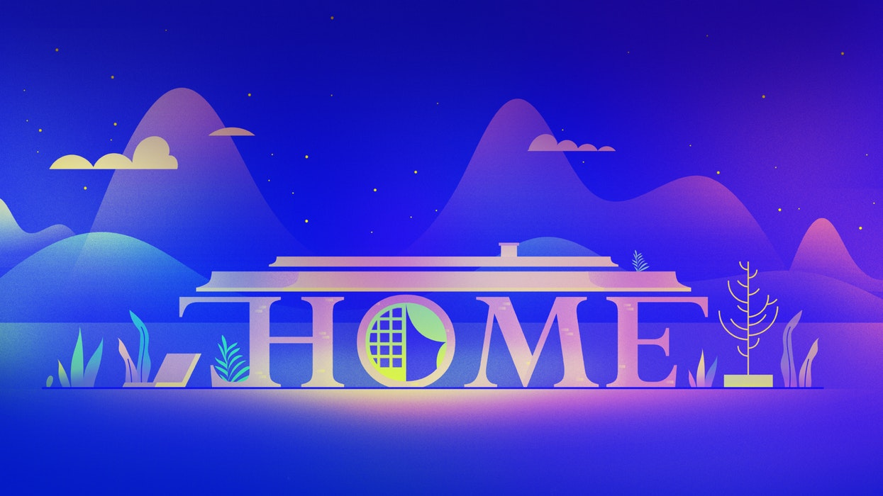 The word Home forming the outline of a house, with mountains in the background