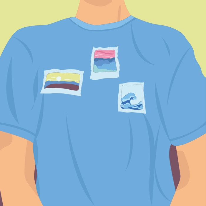 Close-up of a person wearing a t-shirt with images of the ocean on it
