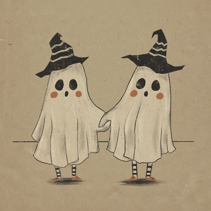 Two little ghosts holding hands, dressed up for Halloween