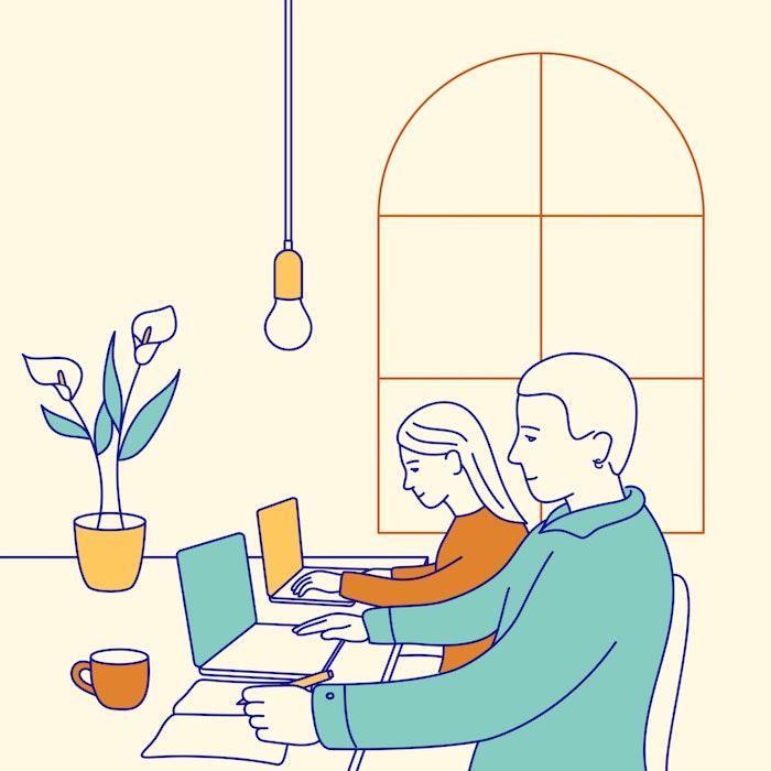 Team members working side by side on laptops