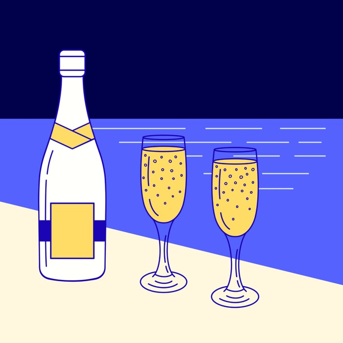 Champagne bottle and two champagne flutes
