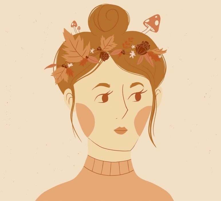 Woman with autumn leaves in her hair