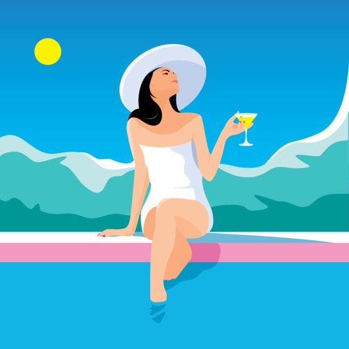 Woman holding a cocktail while sitting at the edge of a swimming pool
