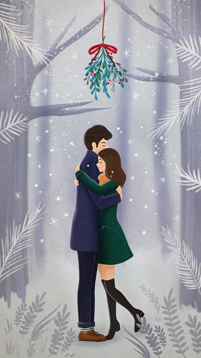 Couple embracing under mistletoe in the snow