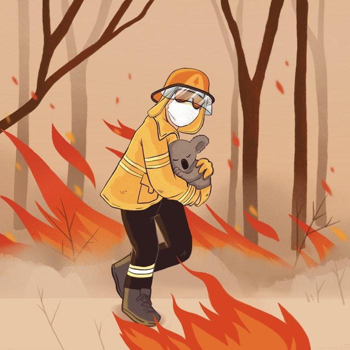 Firefighter rescuing a Koala from the bushfires in Australia