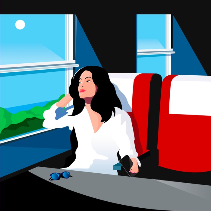 Woman staring out the window of a moving train