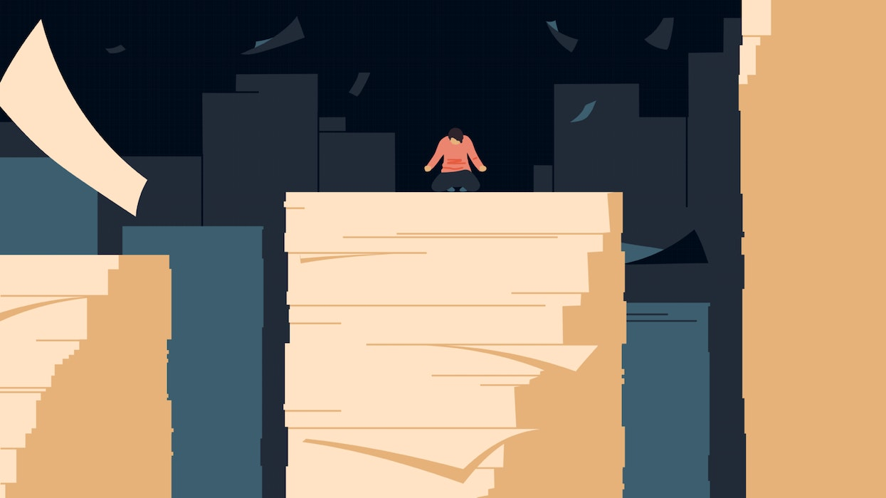 Person overwhelmed by a mountain of paperwork