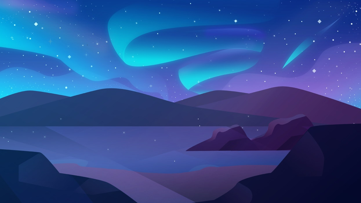 Starry night sky over hills and water