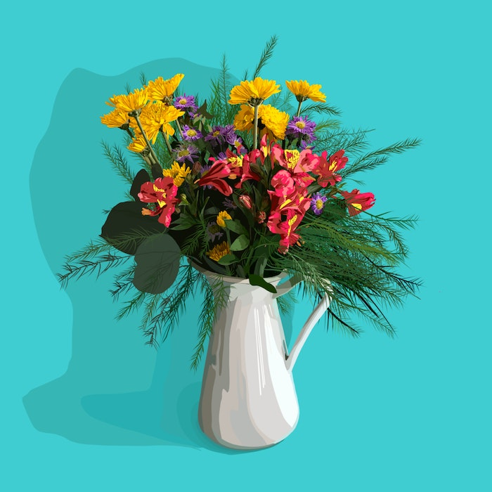 Brightly colored flowers in a white vase