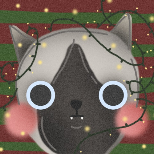 Cat with Christmas lights wrapped around its ears