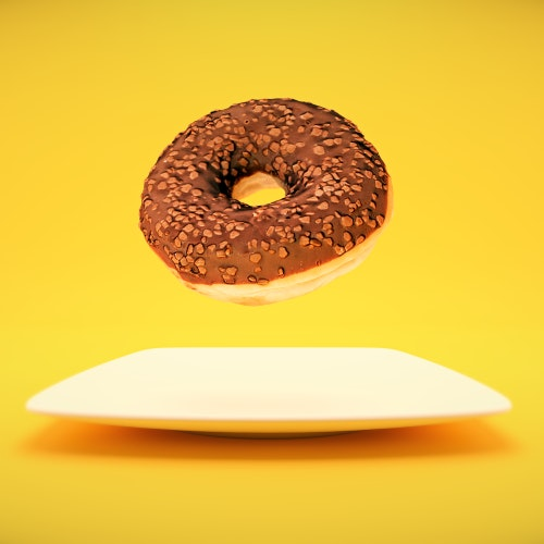 Chocolate Donut floating above a plate