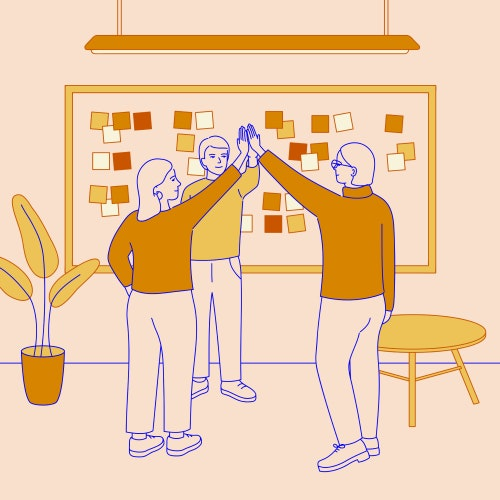 Co-workers doing a high-five after a planning meeting