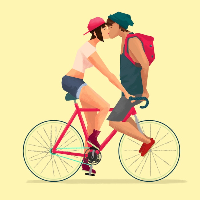 Couple kissing on a bicycle