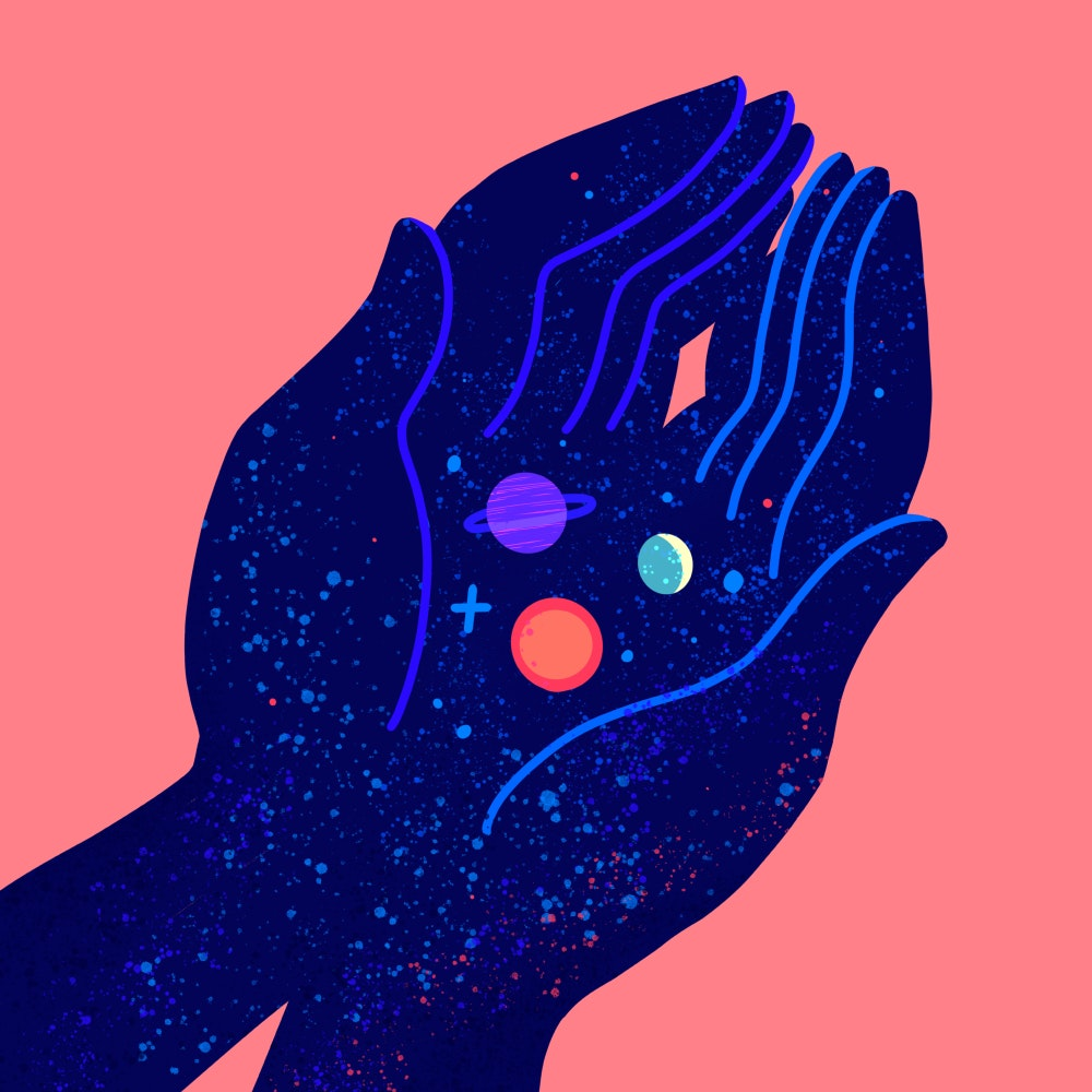 Cupped hands gently holding tiny planets