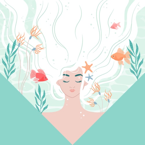 Dreamy woman with fish and seaweed floating through her hair
