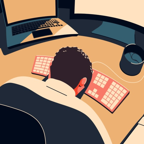 Exhausted man in front of a computer, with his head down on a desk