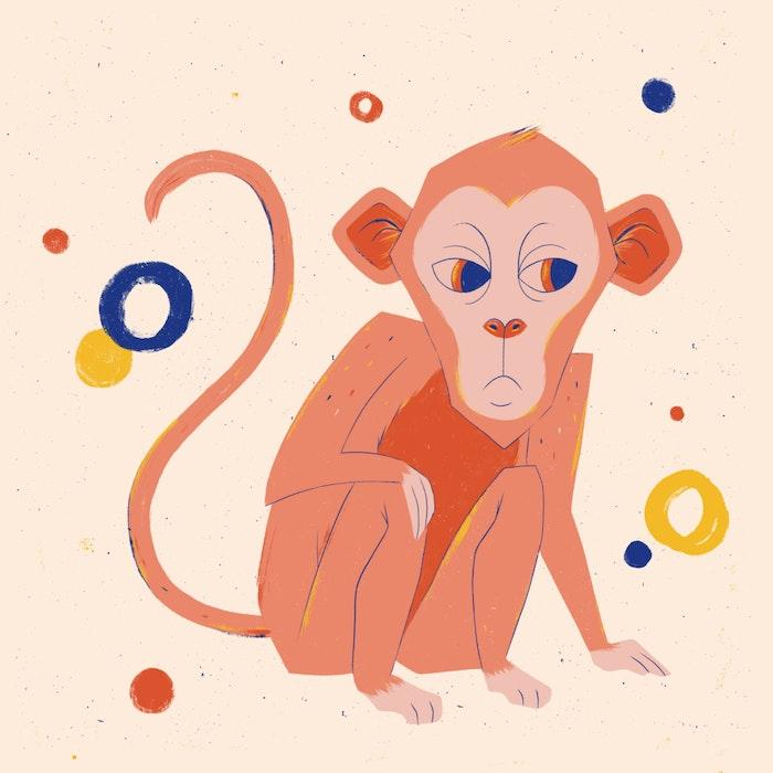 Festive, crouching monkey