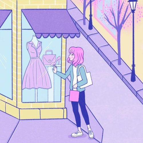 Girl looking at dresses in a city store window