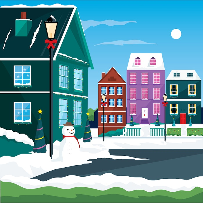 Houses decorated for Christmas with snow and a snowman