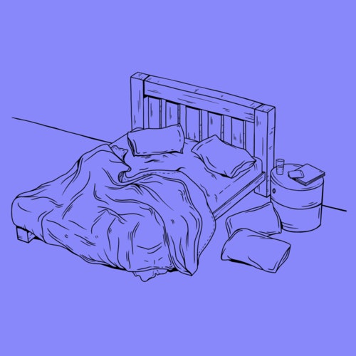 Messy bed with pillows on the floor