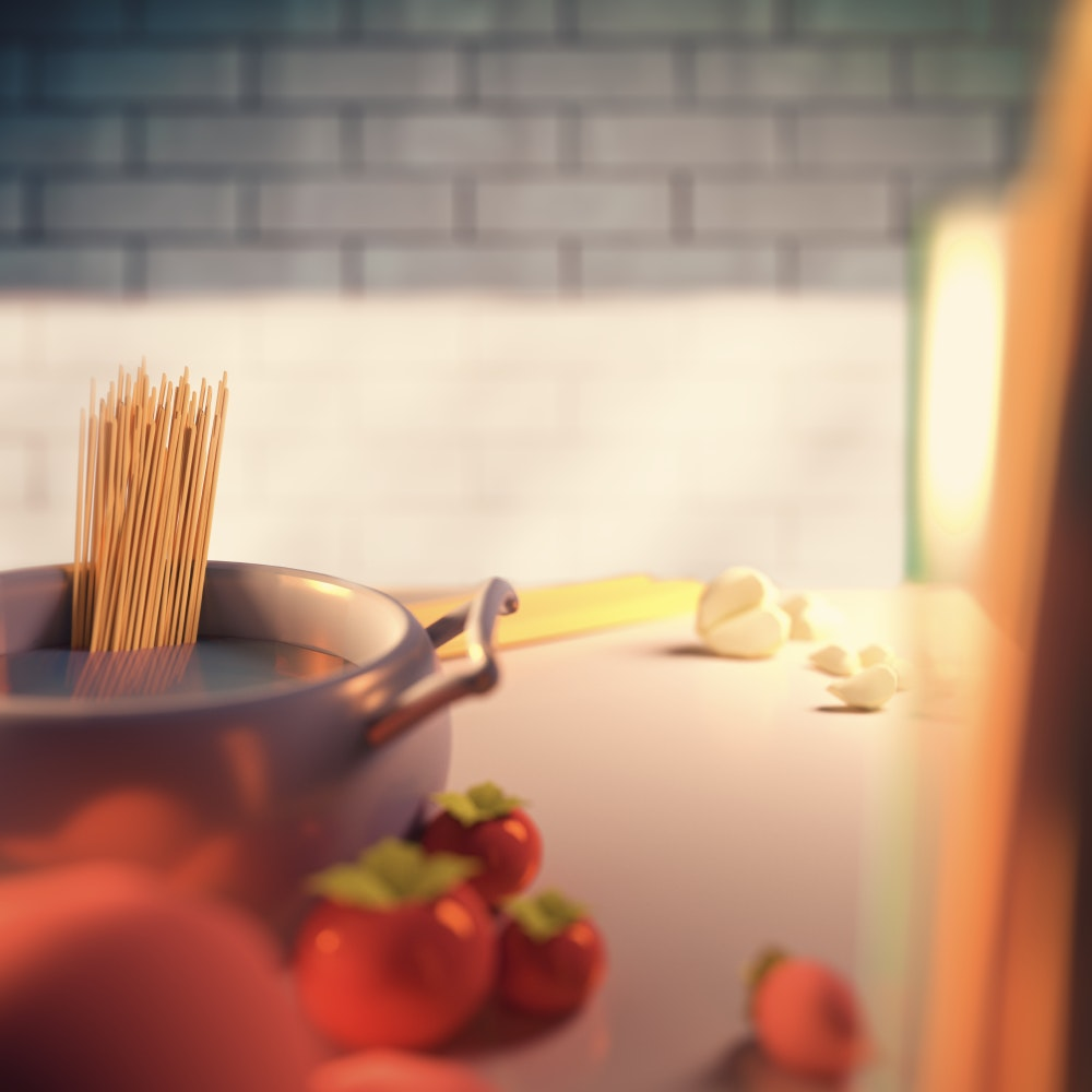 Pasta cooking in a pot and vegetables on a kitchen bench