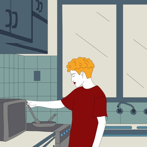 Person cooking on a stovetop in the kitchen