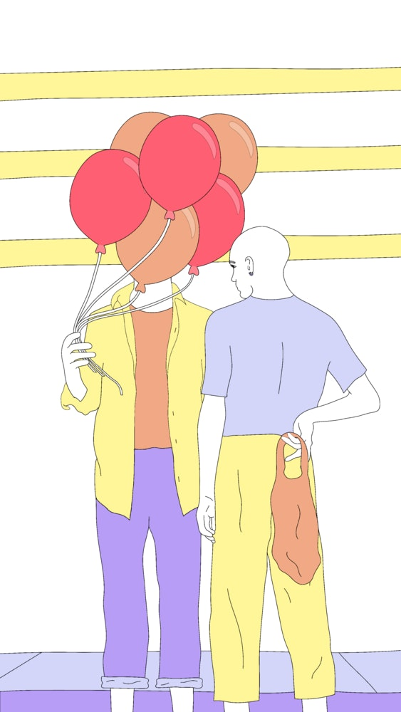 Person holding colorful balloons, standing in front of another person