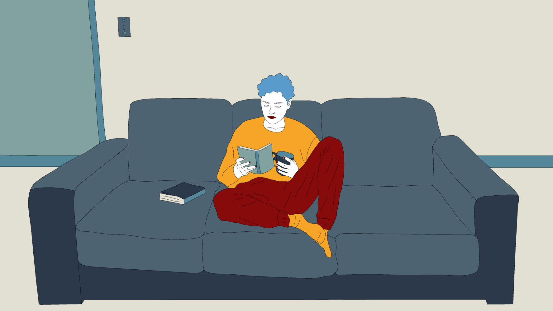 Person sitting on the couch drinking coffee and reading a book