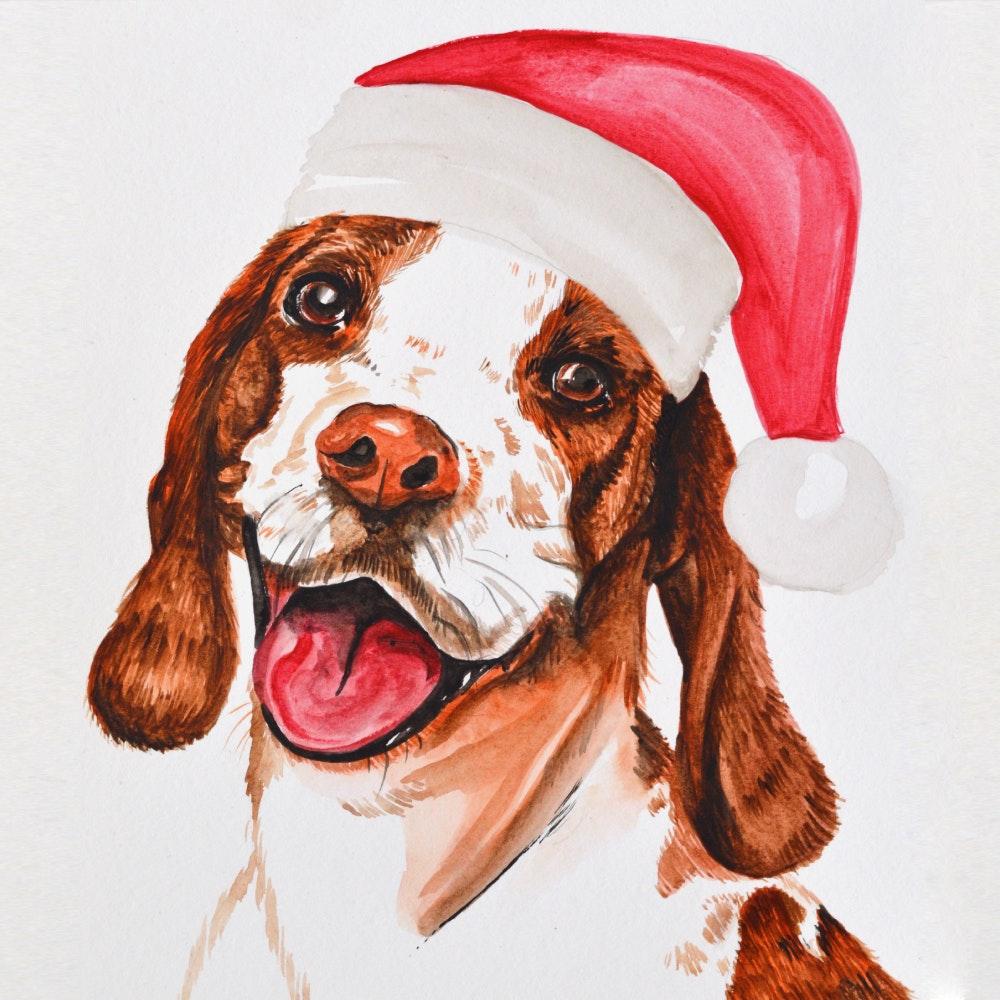 Puppy dog wearing a red Santa hat