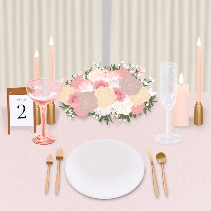 Table decorated for a wedding with champagne glasses, candles and flowers.