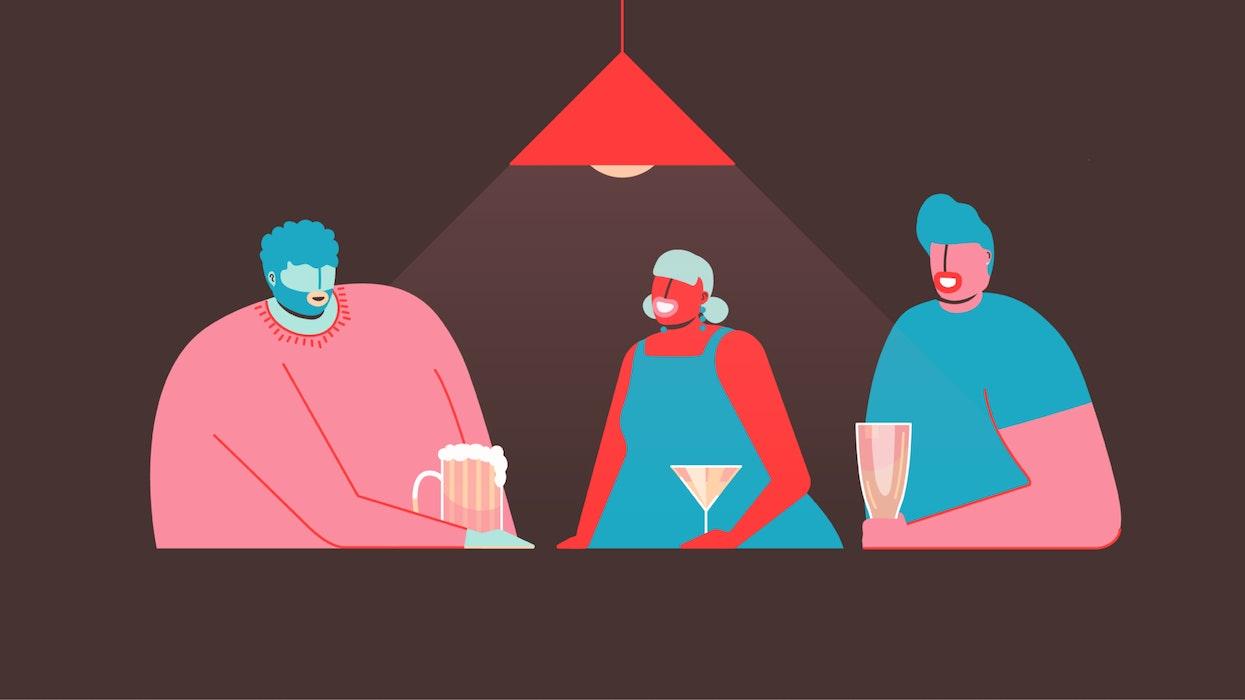Three people sharing drinks at a bar