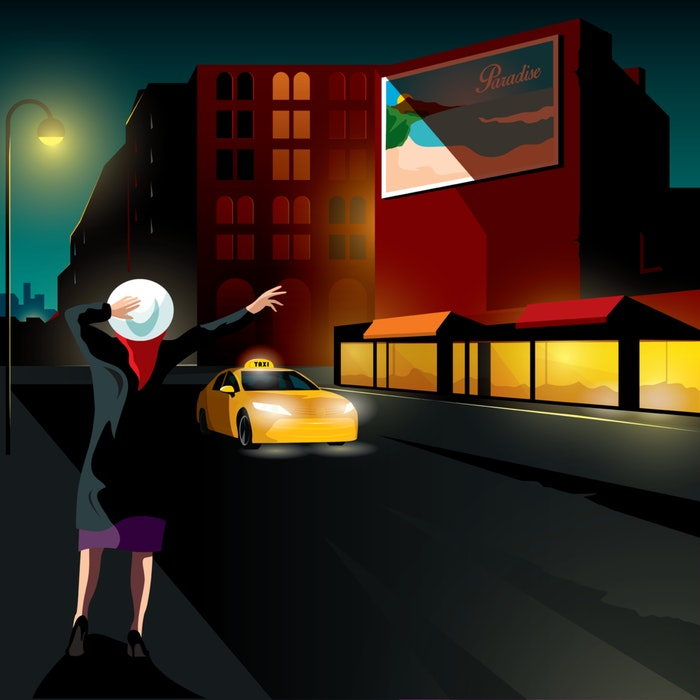 Woman hailing a city cab across the road from a billboard promoting the beach