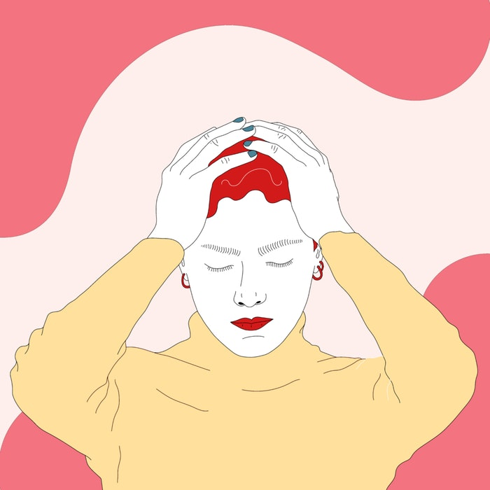 Woman holding her head with both her hands