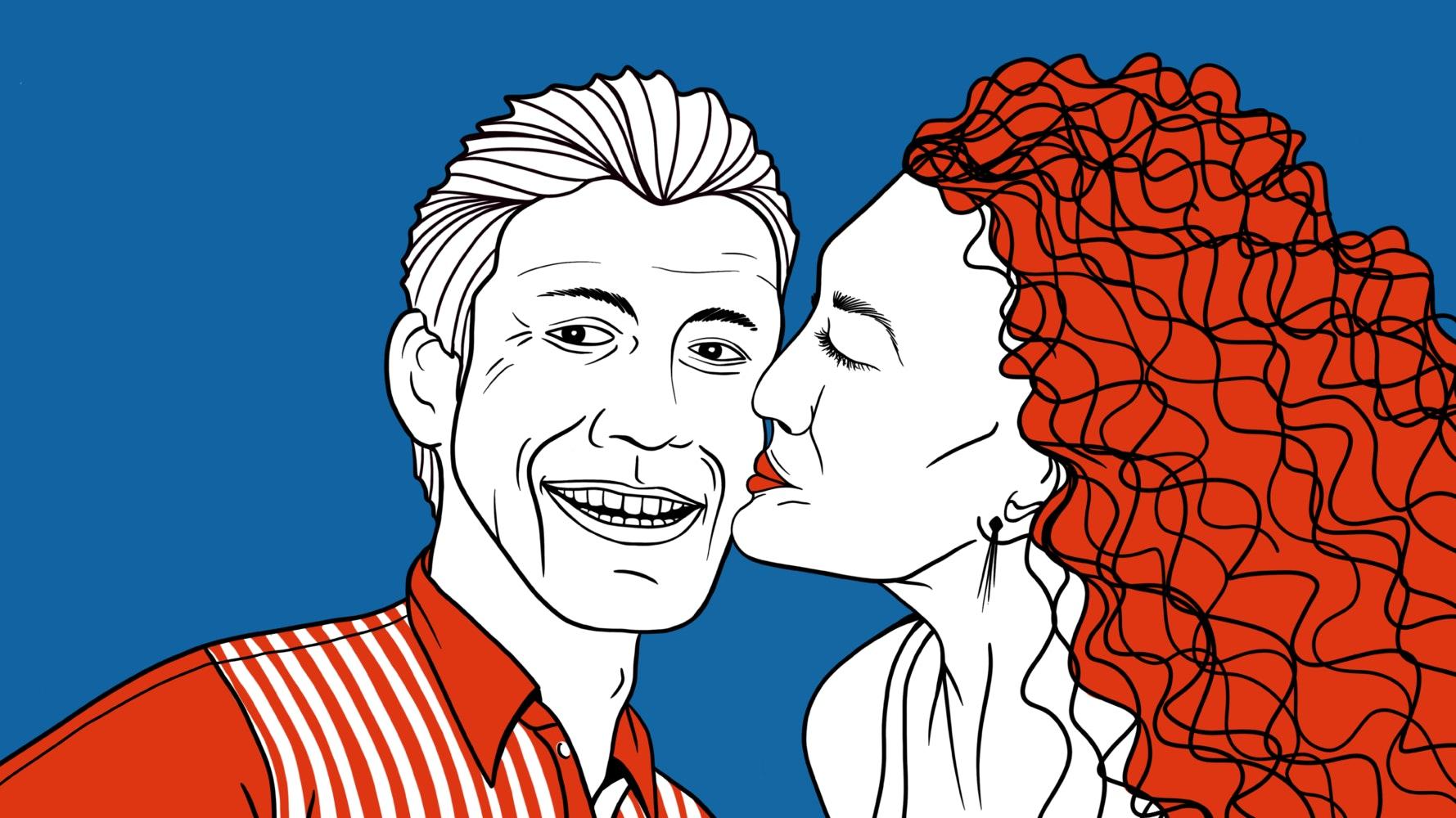 Woman kissing a man's cheek as he takes a selfie