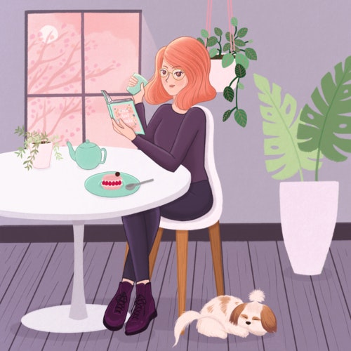 Woman reading a book at home while drinking tea and eating cake, with her dog beside her.