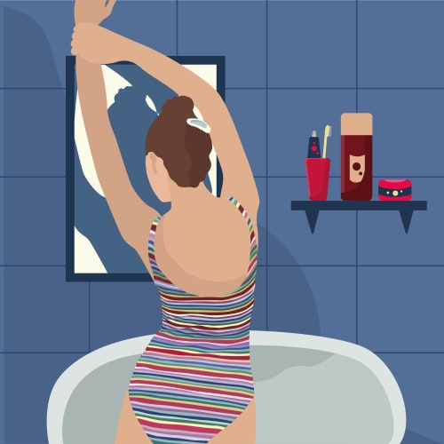 Woman stretching in front of a bathroom mirror