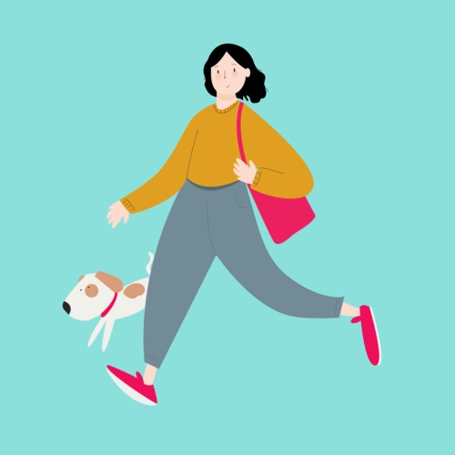 Woman with a handbag walking her small dog