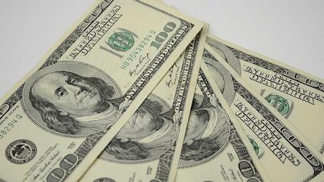 100 dollar bills spinning