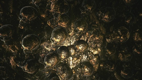 3D animation of a golden surface with skulls