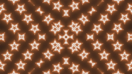 3D rotating starts of orange neon light in a prism