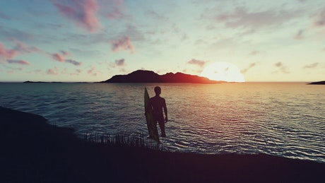 3D surfer on the shore of a beach in a sunset