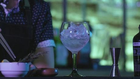 A bartender preparing a drink