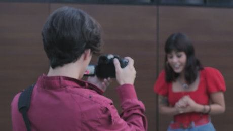 A boy and a girl shooting a story on the street